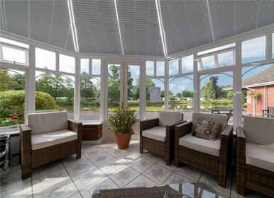 Conservatory fronting lake to relax in